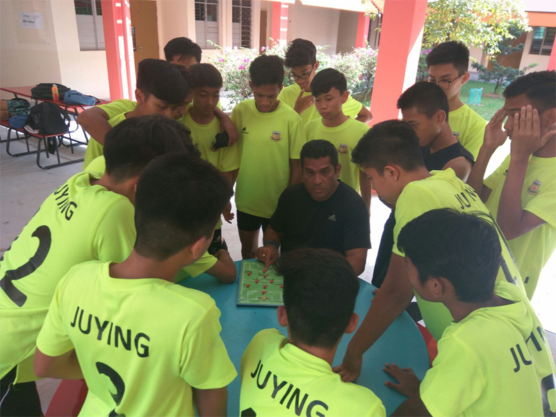 3.Coach Andre strategising with the players during the West Zone Championship  competition.jpg